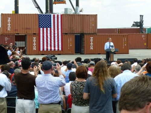 "Surrounded by cargo shipping containers at Port of Tampa, President Barack Obama trumpets increases in US trade. ‎""They don't let me have fun,"" Obama laments Secret Service wouldn't let him operate one of the cranes. (Photo taken by CBS News' Mark Knoller)"