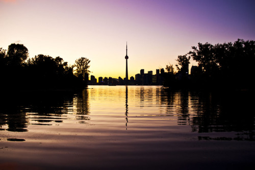"Perfect day to go to the Island, Toronto!  Today's Feature Photo is……  ""Toronto Silhouette"" by Marc Massie  Can't make it out of bed in time to catch the sunrise over there?  See it every day at home.  This piece was shown at PWBs Hidden City event and is available online now in the PWB shoppe.  50:25:25 means that 50% of sales go to the artist, while 25% goes to the PWB partner charity of the buyers choice, and 25% makes it happen. See more online HERE."