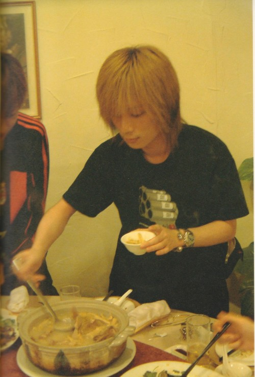 Kaoru eating in Shanghai.  The Japanese Fxxker Family, 2002.