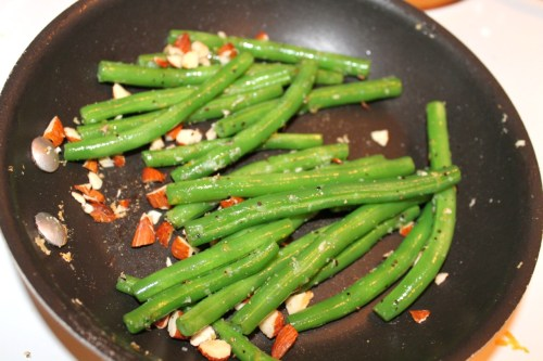 Fresh green beans blanched and sauteed with garlic, lemon zest, sea salt, pepper and  chopped almonds.