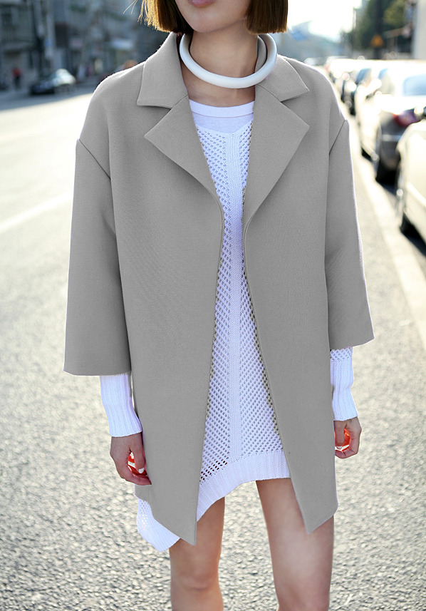 OBSESSED: Structured wool coat and rolled leather necklace.