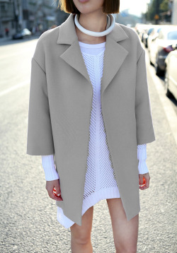 streetstyled:  Love the structured wool coat and rolled leather necklace.
