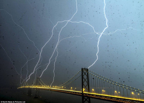 laughingsquid:  Amazing & Rare Photo of the Bay Bridge Being Struck By Lightning