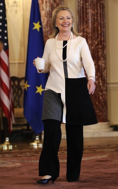 "think-progress:  cheatsheet:  apsies:  Secretary of State Clinton arrives to discuss the just-concluded G-8 Foreign Ministers Meeting, at the State Dept. on April 12, 2012. (Reuters Pictures)  Hillary's having a moment.   We wish the streaker video came up more often when discussing Hillary's ""moment."""