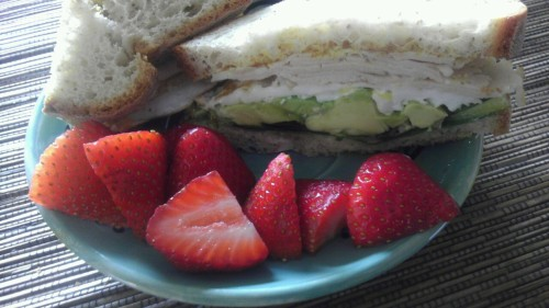 Breakfast sandwich with fresh fruit <3 Udi's bread, organic turkey, one egg, lettuce, avocado, with mustard and mayo.  Balanced breakfast that only took 10 minutes, that's my kinda breakfast.  <3 staying tasty