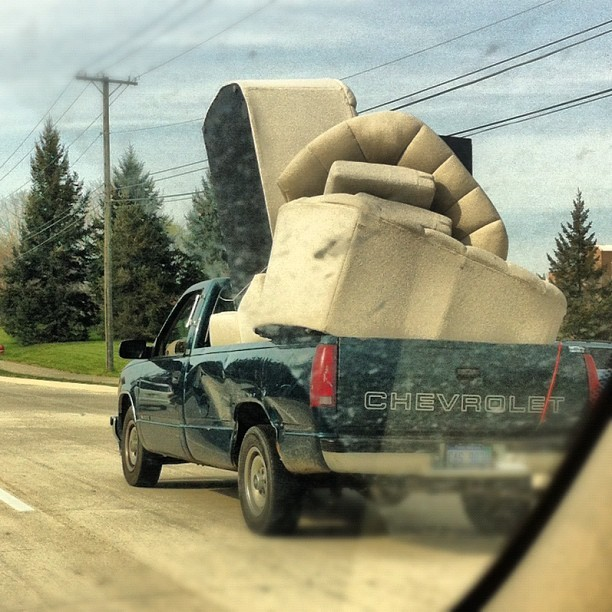 Max capacity…Impressive #funny #driving #couch #overload #michigan  (Taken with instagram)