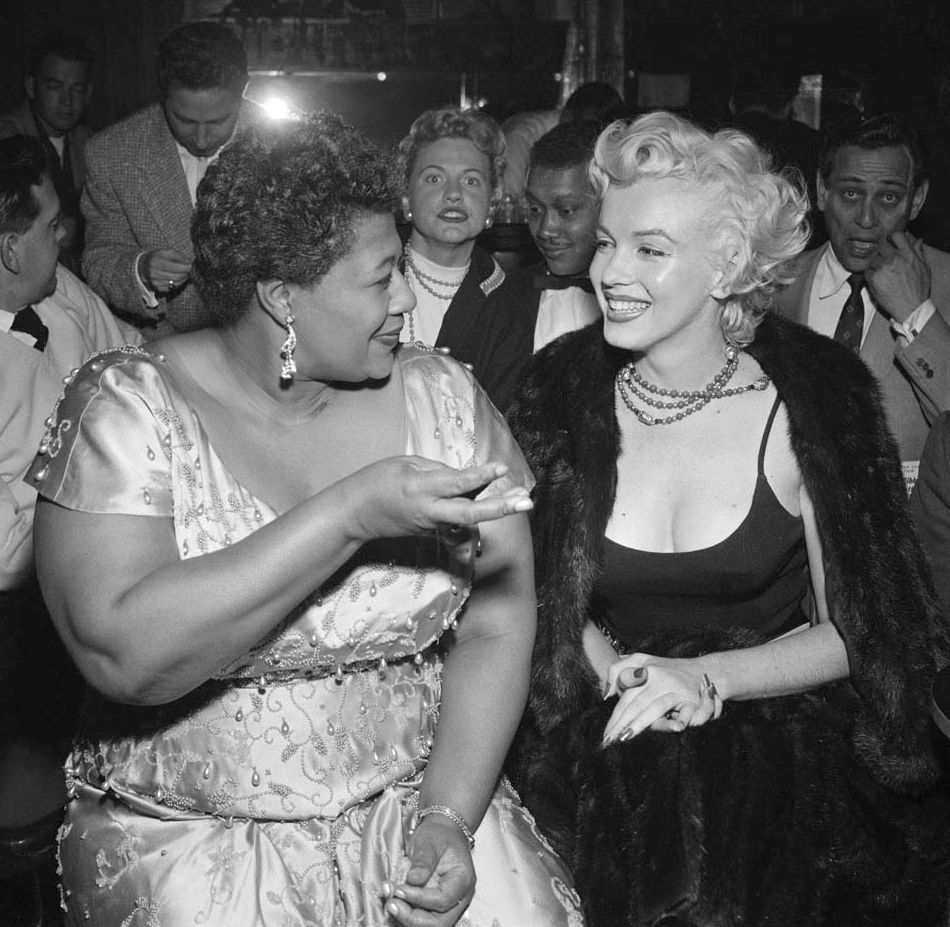theniftyfifties:  Ella Fitzgerald and Marilyn Monroe at the Tiffany Club, Hollywood, 1955.