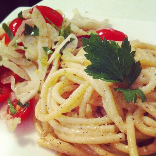 HomeCookin: Cacio e Pepe with fennel, tomato and parsley salad.   Thank you Bon Appetit for the awesome recipe for Cacio e Pepe. I may have tweaked it a little here and there. But generally the recipe was SPOT ON.   Served with a simple Fennel, tomato and parsley salad, this was a deliciously simple Friday night meal…. Cacio E Pepe: Adapted from Bon Appetit 1 packet of Spaghetti, Bucatini, or we used Perciatelli 4 tbsp butter 1 tbsp extra virgin olive oil 1 cup grated pecorino 1/4 cup grated parmigiano 3/4 cup pasta water 2 tbsp fresh cracked pepper  Boil your pasta in salted water till almost al dente. Drain and reserve 3/4 cup pasta water. In a saucepan melt 2 tablespoons of butter over medium heat. Swirl through a little EVOO.  Saute half the pepper for a min and then add the pasta water and simmer.  Stir through the pasta until coated in sauce. Add the remaining 2 tbsp of butter, and the pecorino.  Toss the pasta until the cheese melts through the sauce. Add the rest of the pepper and the parmesan.   Serve immediately!   We served ours with a simple salad. Toss thin slices of fennel with halved cherry tomatoes, a bunch of chopped italian parsley, lemon zest, olive oil, salt a pepper. Toss through with a little squeeze of lemon juice.   Bon App!