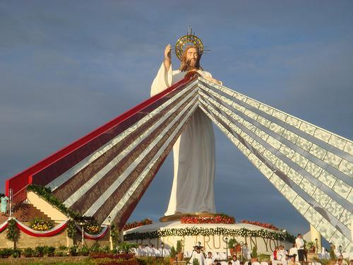 "signum-crucis:  Divine Mercy Shrine, Divine Mercy HillsEl Salvador, Mindanao, The Philippines In the Heart of Jesus from which the rays emanate, is a chapel where the Blessed Sacrament is exposed. The rays are stairs leading to the chapel. The structure at the bottom of the statue is another chapel. †-=:♥:=- Divine Mercy Sunday (the Sunday after Easter Sunday) might be the greatest day of the year due to the immense amount of mercy that Christ pours out upon the earth. Below is the exact wording of the Divine Mercy promise given by Christ to Saint Faustina: Our Lord Jesus said, ""The soul that will go to Confession and receive Holy Communion shall obtain complete forgiveness of sins and punishment. On that day all the divine floodgates through which graces flow are opened. Let no soul fear to draw near to Me, even though its sins be as scarlet… Mankind will not have peace until it turns to the Fount of My Mercy.""—Diary of St Faustina, 699. Why Divine Mercy Sunday is Better Than a Plenary Indulgence"