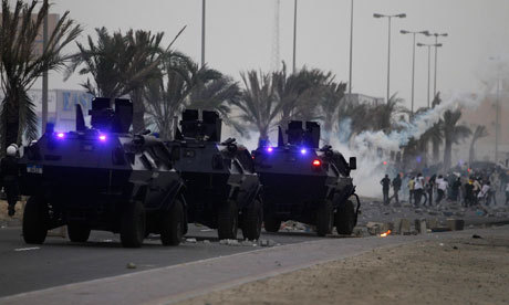 "Bloodshed feared as Bahrain Formula One grand prix given go-ahead Anger as Bernie Ecclestone says Bahrain is 'quiet and peaceful' and ex-policeman John Yates claims it's safer than London Human rights activists fear further bloodshed and a violent crackdown by authorities in Bahrain after race organisers gave the green light to next weekend's Formula One grand prix in the troubled Gulf kingdom. As the Fédération Internationale de l'Automobile (FIA) said it was satisfied that all proper security measures were in place for the race on 22 April, Nabeel Rajab, from the Bahrain Centre for Human Rights (BCHR), said: ""I'm afraid we might see local people who will be killed in the coming days because of the F1."" Anti-government protesters have called for the event to be cancelled, arguing that it lends legitimacy to a regime which continues to perpetrate human rights abuses. The FIA, the sport's governing authority, confirmed that it would go ahead, with beefed-up security, after receiving reassurances. John Yates, the former assistant commissioner of the Met who is in Bahrain advising on police reform, wrote to the FIA president, Jean Todt, to say he felt safer living in Bahrain ""than I have often felt in London"". Bernie Ecclestone, 81, the F1 supremo, speaking at the Chinese Grand Prix in Shanghai, said of Bahrain: ""I know people who live there, and it's all very quiet and peaceful."" The comments provoked a storm on social media sites as local activists said there were fears of a clampdown on protesters to prevent disruption to the event. Pictured: Riot police in armoured personnel carriers fire tear gas at protesters during clashes after the funeral of Ahmed Ismaeel on Friday in the village of Salmabad, south of Manama, Bahrain. Photograph: Hamad I Mohammed/Reuters"