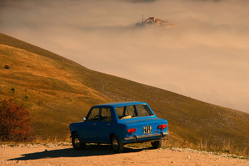 Fiat 128 at Piano Grande, Monti Sibillini, Umbria, Italy; Casttelucio in background (by Eifeelgood)