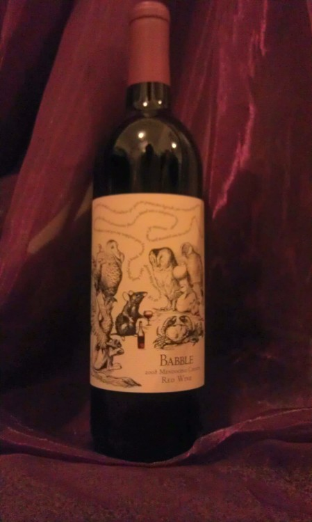"Tis week three of the Trader Joe's wine blogging adventure! Last week, I featured one of my go to red's, Cocobon. The wine is easy to drink and a crowd pleaser. This week, I ventured out of my comfort zone, and decided to try something new, just as I promised! This week's featured wine is ""Babble"", a 2008 Red Blend containing 13.70% alcohol. The bottle was definitely eye-catching sitting on the store's ""New Item"" shelf. The label has a picture of animals surrounding a rat with a glass of wine. The rat appears to be the connoisseur describing the wine.  ""It's an insouciant little vintage that's both playful and brash, brawny and confident, but with just a smidgen of unctuousness that allows its provocative flavors to blend into a voluptuous tastescape-evocative of a more well-muscled wine but without the plonk one would normally associate with such a naturally grandiose and typically overstated varietal all wrapped up in a piquant finish that's not short on opulence,"" says the rat. The description of the wine is, as the name of the wine states, all a bunch of babble. I mean this literally. I was not too impressed with this wine when i took my first couple of sips. I was doing homework and felt that some wine would relax me a bit, except I did not get past four sips. My roommate came into my room about an hour later to see what I was up to. She saw that I was having some wine and asked to taste it when she saw my unsatisfied face. SIDENOTE: My roommate is a fan of sweet, sparkling wines. Have you ever heard of Stella Rosa? It is a very sweet, low alcohol containing wine. My roommate NEVER likes the wines I drink.  Back to my story, she said, and I quote because I must stress how shocked I was, ""Hmmm, this is not as bad as the other ones [wines] you've bought."" My jaw dropped, and I glared at her because I really did not know how to respond to that. I reminded myself that everyone has their own taste in wine, but how does this make any sense?! I looked at the clock, and noticed an hour had passed since I had opened the bottle. The wine had aerated, or breathed, which can make a big difference in what a wine tastes like. I figured that because my roommate, who cannot stand most red wines I buy, liked the wine, I had better try it again. Sure enough, the wine tasted much better after breathing for an hour. I bet you are wondering why I originally did not like the wine. I am no expert here, but I thought that the wine was on the flat side. I do not mean flat as in a bubbly lost its bubbles; I mean flat as in the wine did not do anything for me except leave a bad flavor in my mouth. After aerating for an hour, the wine had a softer finish and was more enjoyable to drink. The Mendocino County Red Wine is blend of:      36% Petite Sirah      26% Syrah      17% Merlot      10% Carignane      10% Grenache      1% Malbec The flavors found in the wine include plum, bacon fat and blackberry preserves with considerable rounded tannins in the finish. I would recommend this wine be consumed with dinner, not on its own. To sum up whether I liked this wine, I will create a scenario a true Joe's customer can relate to. Trader Joe's customers are always heart broken when finding out about their favorite foods being discontinued. With that in mind, if this wine gets discontinued, my heart will remain in tact. The wine is a Trader Joe's exclusive offered at $6.99 a bottle.  I do not regret buying it, and I am glad I gave it a second chance after it aerated. It was definitely a valuable lesson. Next week, the wine choice will be a mystery to the both of us. Maybe I will ask an employee for a suggestion? Maybe I will pick at random? Maybe I will choose something foreign? Til then, have some wine and relax, the weekend is here."