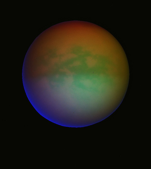 "the-star-stuff:  Titan in ""Methanovision""  Methanovision composite of Titan assembled from Cassini raw images taken on August 25, 2009. White areas correspond to areas with more methane absorbtion (less haze) and red-brown area correspond to areas with more haze (north polar hood). Image credits: NASA/JPL/MikeMalaska"