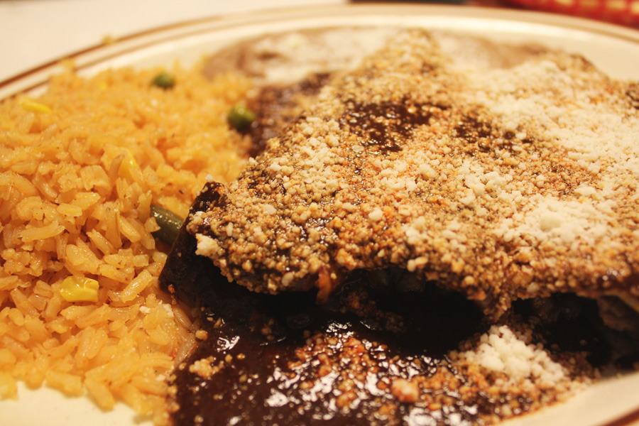 Enchiladas poblanas (beef enchiladas with mole sauce) from Super Antojitos (aka Super A's). So good.