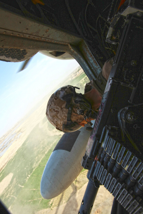 Sgt. Matthew Marsh, a Crew Chief with Marine Heavy Helicopter Squadron 362 and Toledo, Ohio, native, searches the surrounding area for activity during a vehicle interdiction operation in southern Helmand province, Afghanistan, April 7, 2012.Read more: http://www.dvidshub.net/image/559221/ugly-angels-assist-3-3-narcotics-weapons-search-operation#.T4lBfmBVODA#ixzz1s0Mw5YKG