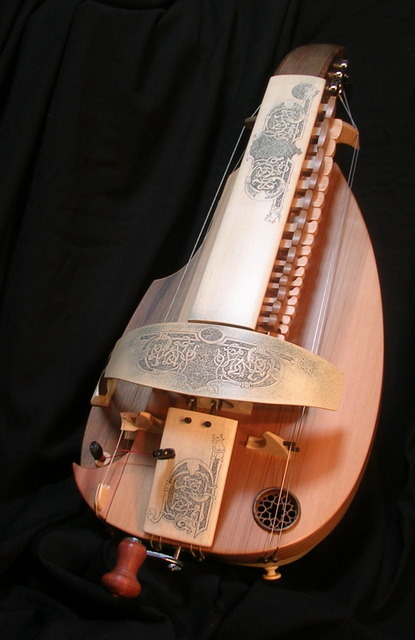 Two nice new hurdy-gurdies have appeared for sale on Philippe Mousnier's site.  A beautifully decorated alto (see photo above) for Euro 4300 and a simpler student instrument for Euro 1700.  I doubt they'll be available for long!