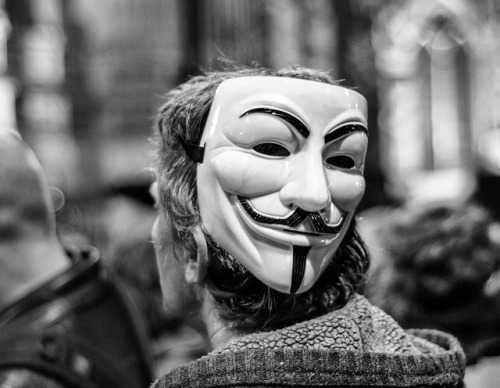 seanbattenphotos:  Two Face on Flickr. A protestor at the Occupy St Pauls march on 5th November 2011