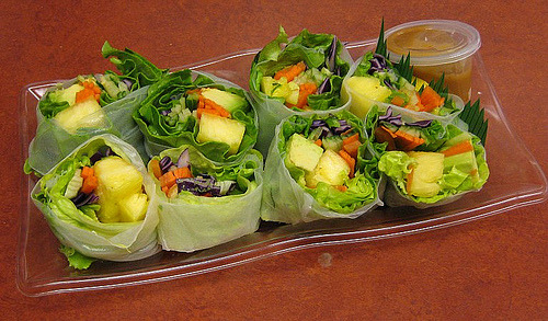 "Fruit & Veggie Sushi (by groovehouse) ""Avocado, pineapple, carrots, purple cabbage, lettuce, spring roll wrapper and peanut sauce."""