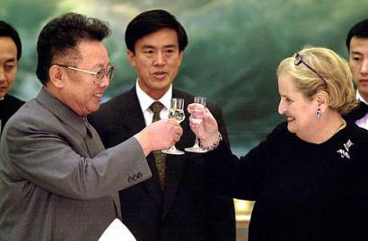 In 2000, U.S. Secretary of State Madeleine Albright met with Kim Jong Il on a state visit to North Korea. At the time, she was the highest level American official to have ever met with the diminutive dictator. Although the two had several serious discussions regarding the frosty relationship between the United States and North Korea, Albright reported that Kim was surprisingly jovial, cracking several jokes and making a point to ask her how she was enjoying her visit. Albright and Kim (whose love of expensive French cognac is well documented) are seen here happily clinking glasses as other officials look on.