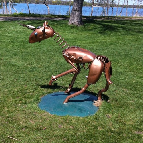 "This sculpture is called ""Recycled Deer."" It's a creation by Albert Belleveau's of Puposky, MN. You can see it on the south side of Lake Nokomis. I was confused by the title because it has a single horn, making it either a unicorn or a rhinoceros, with the former being more likely. I found an older photo online and that version had deer antlers. So, ""Recycled Deer"" it remains."