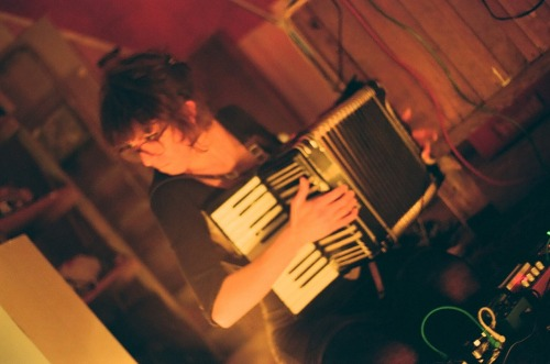 me playing accordion, by Tanya Mar.