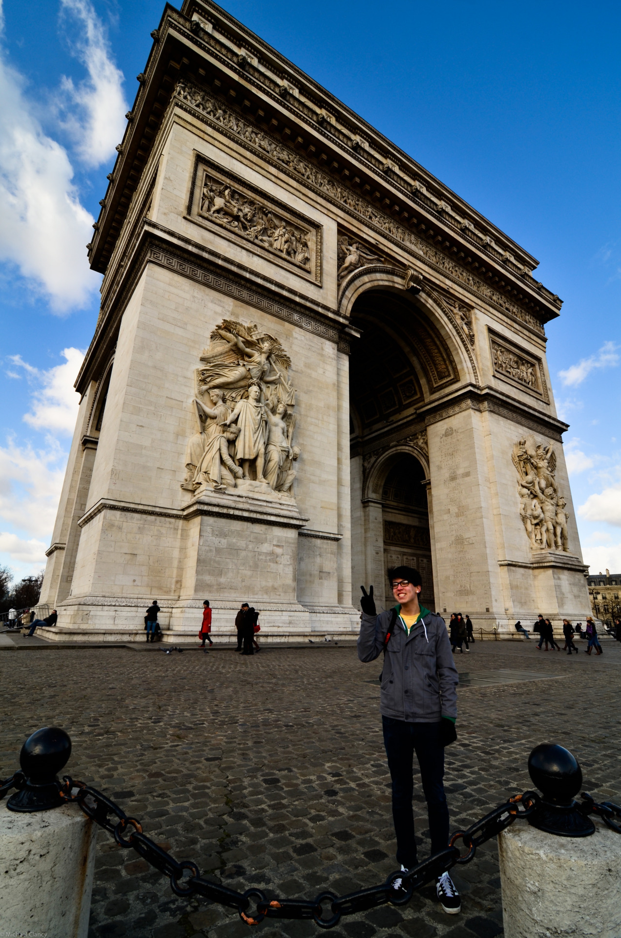 Kiel in front of le Arc de Triomphe Paris, February 2012 Someone refused the whole trip to give me a classic Japanese peace symbol in photos, yet I managed to convince him to flash them in front of the Arc de Triomphe, on the condition it didn't appear on the internet…