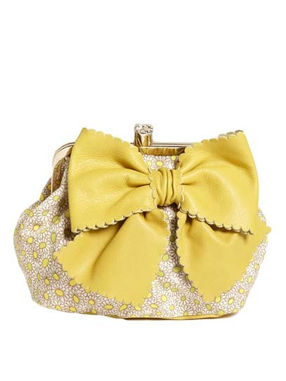Doll up your prom look with a bow-bedecked purse, like this sweet yellow clutch from Red Valentino. Check out more party-ready bags here » nordstrom.com