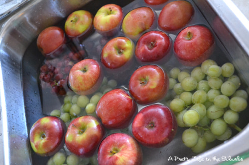 defeat-the-lazy:  Cleaning Fruit - fill sink with water, add 1 C. vinegar, mix. Add all fruit and soak for 10 minutes. Water will be dirty and fruit will sparkle with no wax or dirty film.