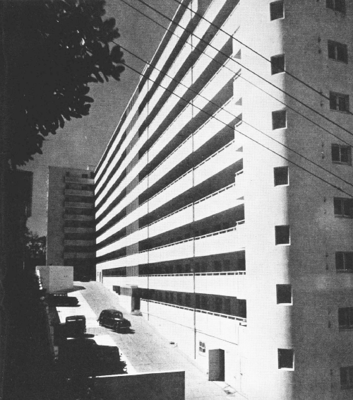 Dixon Street flats, Wellington, New Zealand (circa 1947). Constructed in 1936, this block provided 116 one bedroom flats for workers on a one acre site. Constructed using a cellular system, doing away with columns and beams, making the building more earthquake resistant.