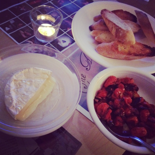 tonight's dinner: brie with honey, balsamic roasted tomatoes, and toasted baugette. so so good!