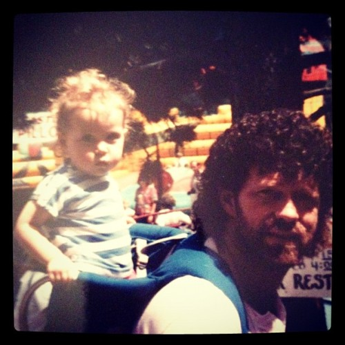 My dad and his hair is awesome. His hair still looks like this but with a salt and pepper color and a little shorter.  Growing up I was a daddys girl for sure. I remember going to Disney world when I was a little little girl and all I wanted to do was go on the water slide, swim in the pool, suck my thumb, and hold my blanky. While my sisters and mom went to go on rides and explore disney world my dad was there catching me at the end of the slide every time.