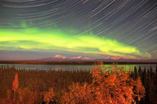 Star trails + snow capped mountains + aurora… FTW