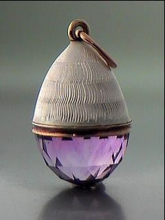 berengia:  Faberge: white guilloche enamel and faceted amethyst egg pendant with gold mounts, workmaster Feodor Afanasiev