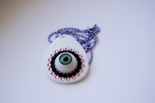starchildbysaffron:  New pendants are up! When I made this pendant, I wanted something cute and creepy, but simpler than my other eyeball necklaces. This is what I came up with! I call it the Jeweled Eye Pendant ♥
