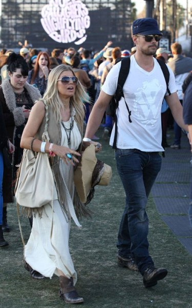 Fergie and her husband, actor Josh Duhamel, at the second day of the Coachella Music Festival yesterday…