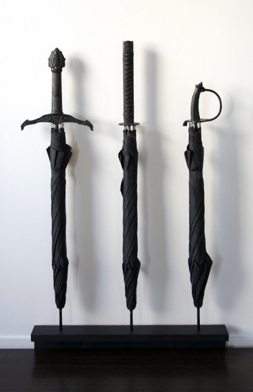 laughingsquid:  Sword Handle Umbrellas  These would be badass.