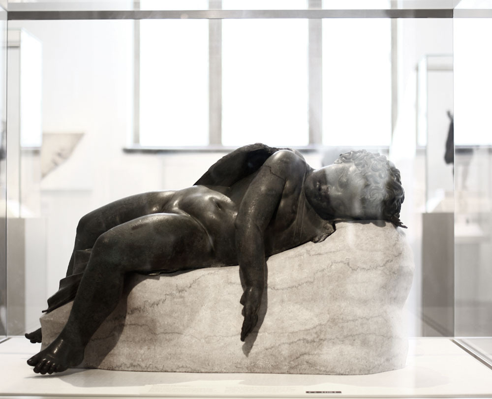 Bronze statue of Eros sleeping Hellenistic or Augustan period, 3rd century B.C. - early 1st century A.D.