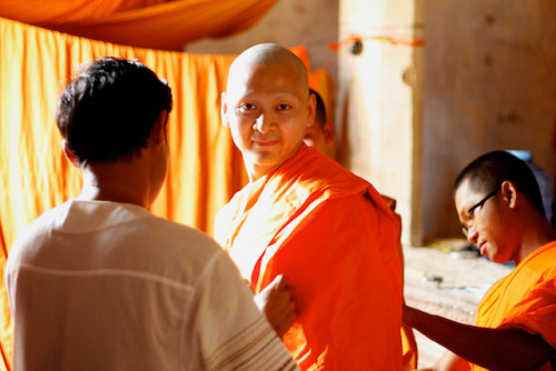 A newly minted monk gets his robe. on Flickr.