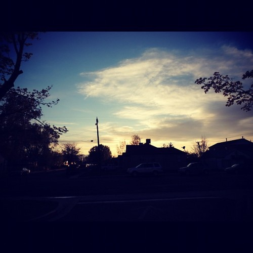 #sky #skyline #silhouette #sunset #blue #orange #building #house #tree #trees  (Taken with instagram)