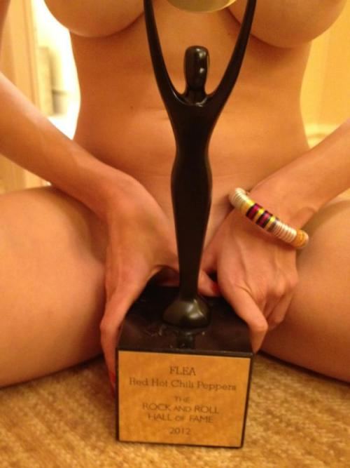 Flea's girlfriend poses with his shiny new Hall of Fame Induction Award!