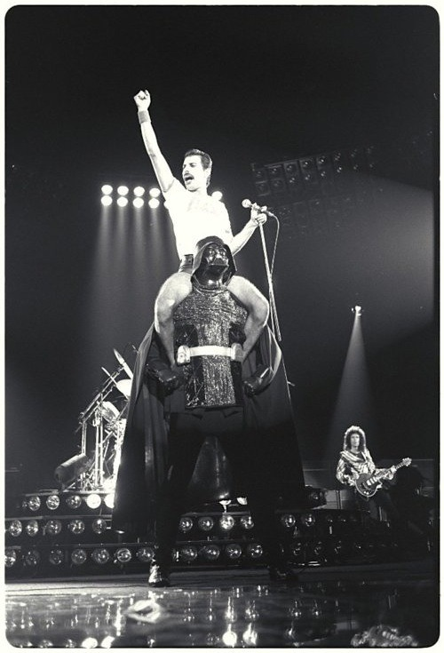 "curiositycounts:  Yes, that is Freddie Mercury riding Darth Vader. And yes, that is the epitome of pop culture perfection. (via)  ""Polish the helmet"""