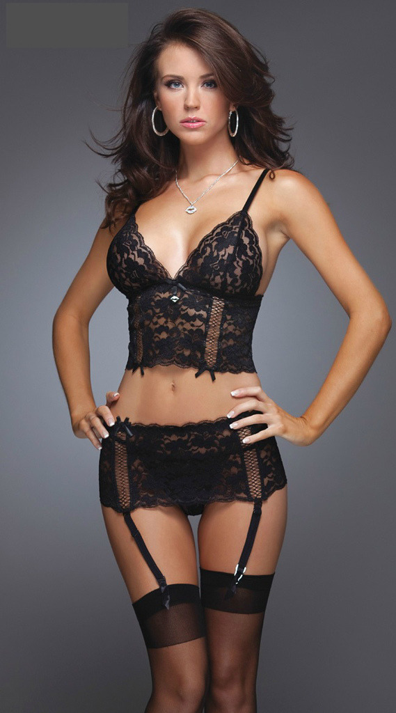 Super hot brunette in black lace lingerie and garter stockings.
