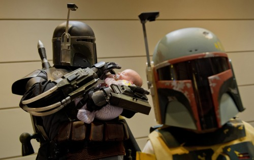 nationalpost:  Mike Pitul (Boba Fett) holds his baby daughter Ariadne as he waits in a lineup during a children's costume competition at Wizard World Comic Con at the Metro Toronto Convention Centre in Toronto Sunday. (Photo by Tyler Anderson/National Post)