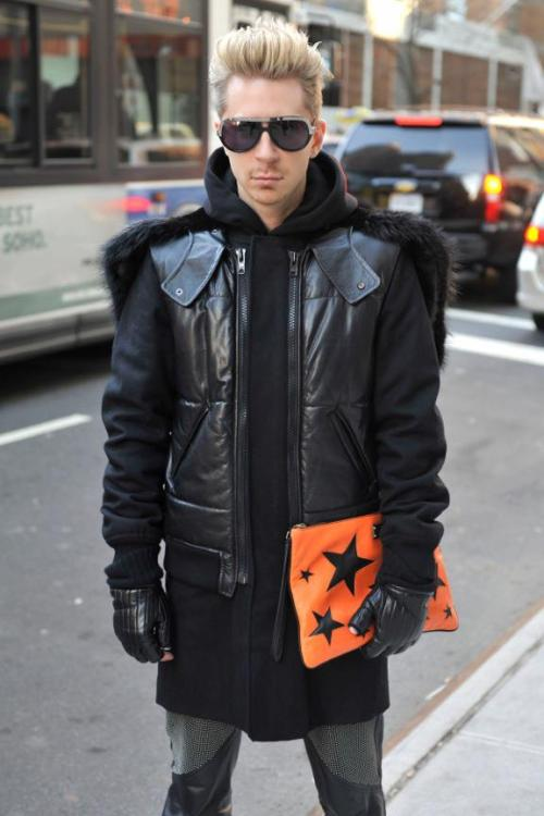 Kyle Anderson Accessories Director of Marie claire Wearing Givenchy coat and Dolce & gabbana bag at NY fashion week.