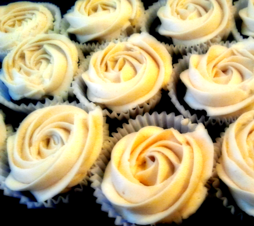 BLACK BOTTOM CUPCAKES WITH CARAMEL FROSTING!!!  Well there's another office birthday and the birthday boy likes cheesecake. Perfect reason to try out black bottom cupcakes (chocolate cupcakes with a cheesecake center). I used a recipe from Smitten Kitchen and they turned out super tasty!  Frosting isn't required on these types of cupcakes, but 1. I thought caramel frosting would taste awesome with chocolate and cheesecake (I was right) and 2. I have a wedding order next weekend and needed to practice my frosting rose swirl. Not too shabby. I'll have to tidy up the edges for the wedding ones though.