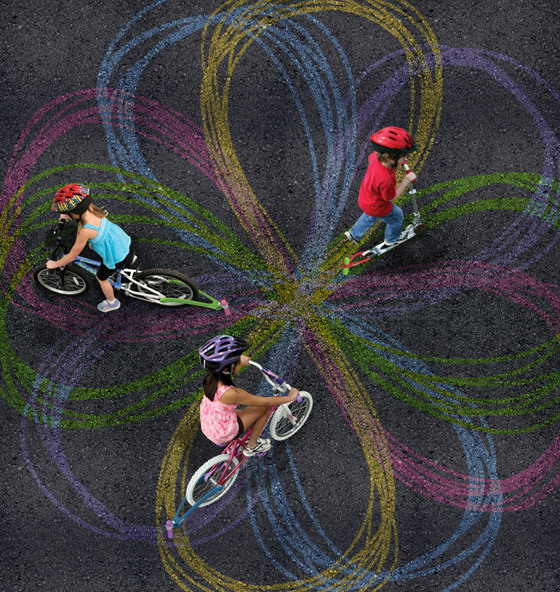 Chalk art created by bikes. And it goes to raise money for something or another.