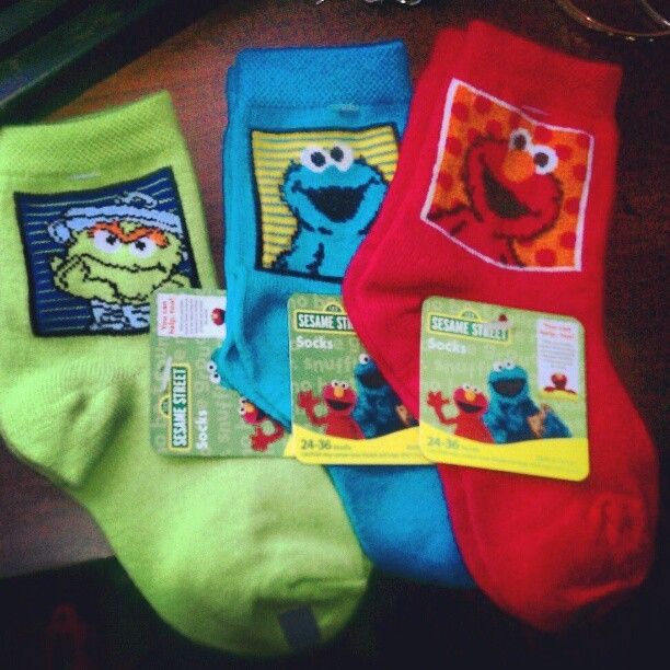 A'veri used his allowances to surprise me with some Sesame Street socks. I love that little boy. #socks #sesamestreet #elmo #fashion (Taken with instagram)