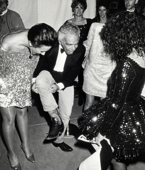 avenzhang:  Ralph Lauren showing designers Betsey Johnson and Donna Karan his cowboy boots,1990   Vintage Donna, Ralph & Betsy. Oh and my boss Patti in the background.