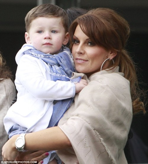 Celebrity Scarf Watch: Kai Rooney with mother Coleen Rooney, sporting a light blue scarf. Our youngest scarf-spot yet!