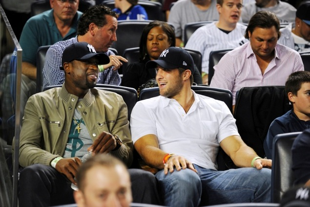 Glad Tim Tebow and Dwyane Wade wore classic Yankees caps at last night's game, not abominable fashion bastardizations.